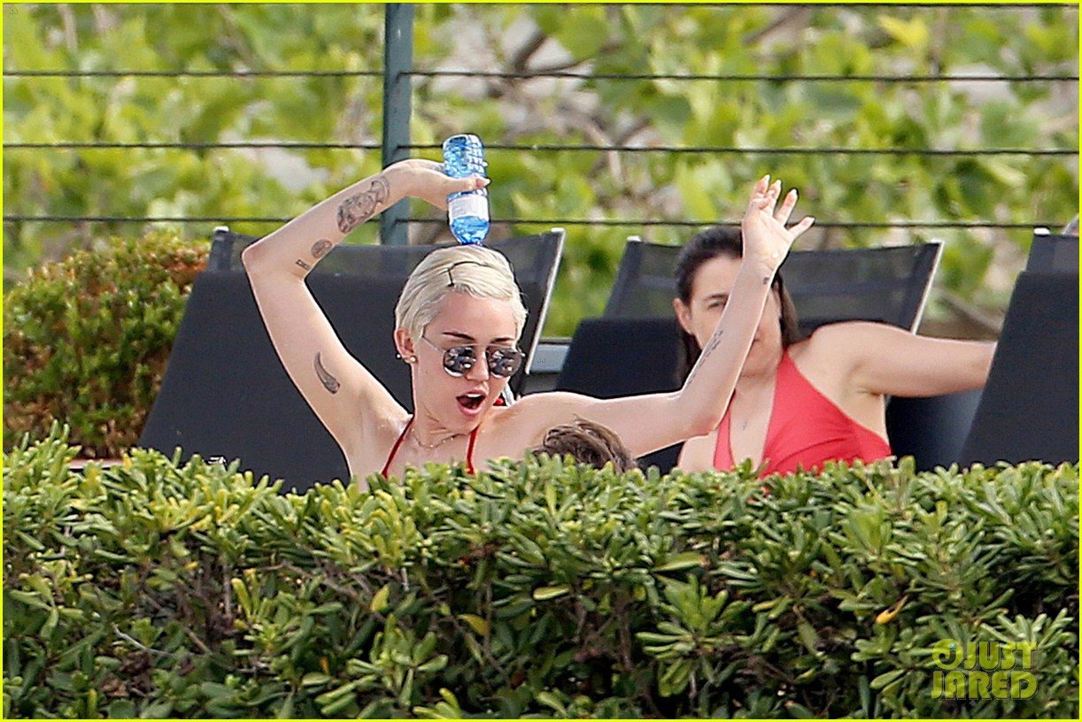 miley cyrus wears a bikini douses herself with water 113134810