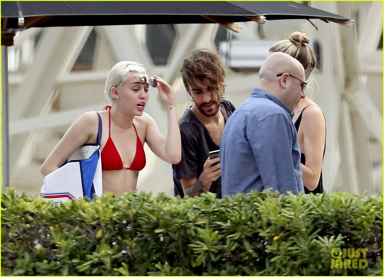 miley cyrus wears a bikini douses herself with water 233134822