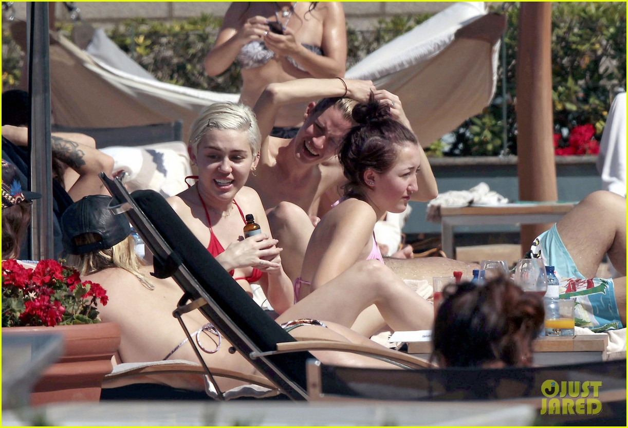 miley cyrus wears a bikini douses herself with water 243134823