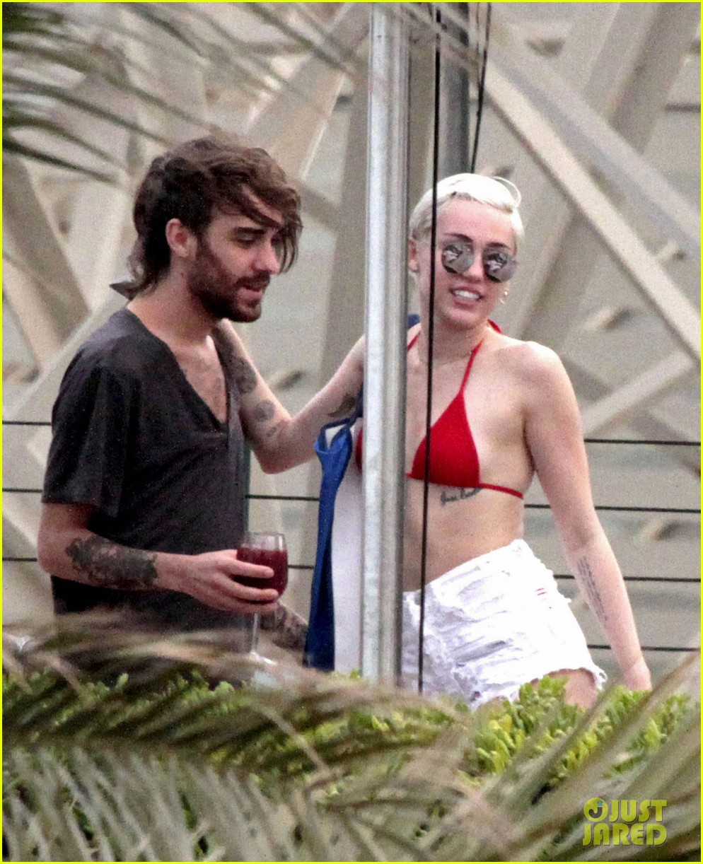 miley cyrus wears a bikini douses herself with water 283134827