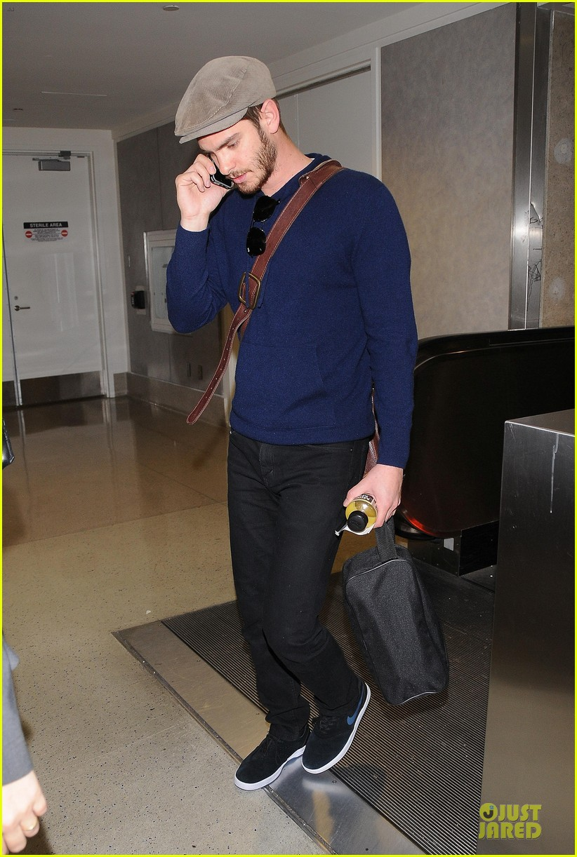 emma stone andrew garfield land in los angeles separately 033125458