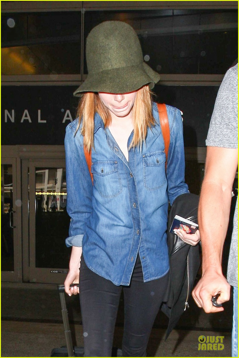 emma stone andrew garfield land in los angeles separately 173125472