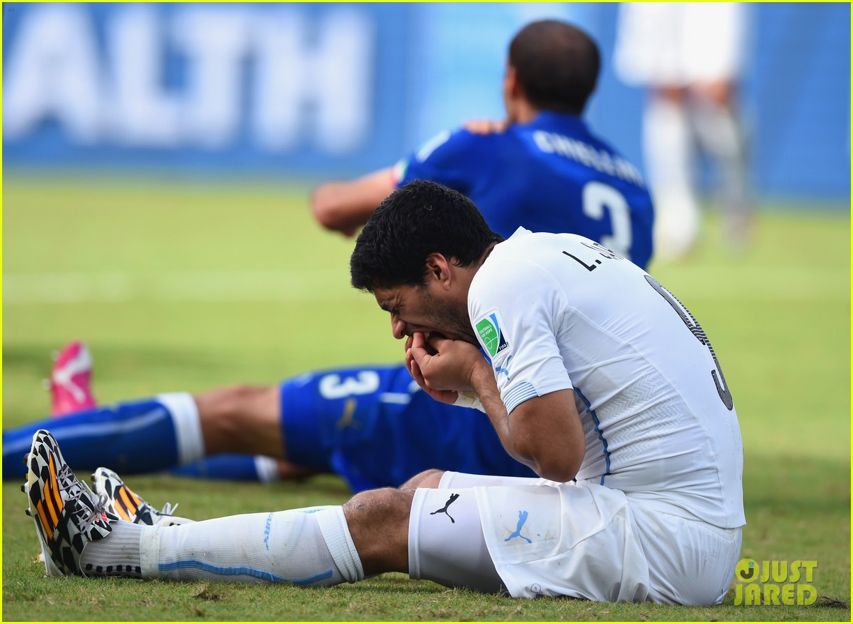 luis suarez banned from world cup for biting opponent 013143916
