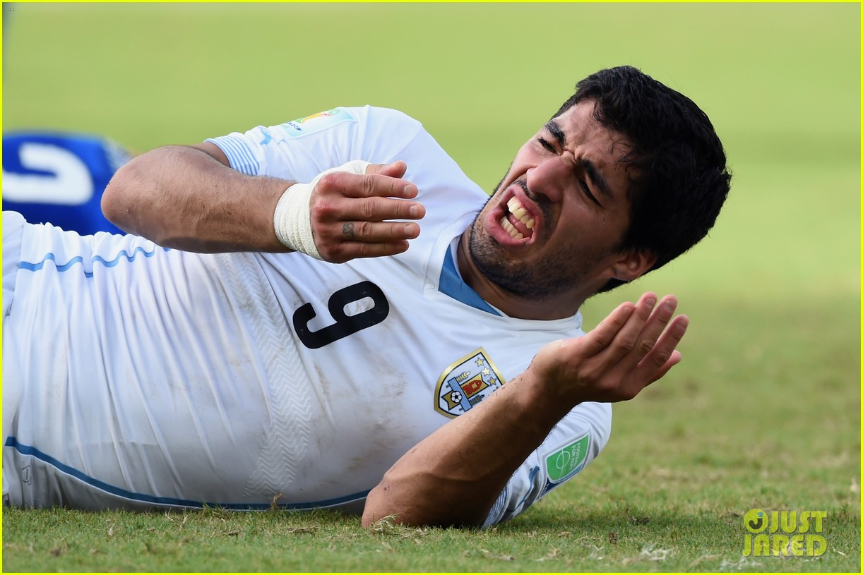 luis suarez banned from world cup for biting opponent 023143917