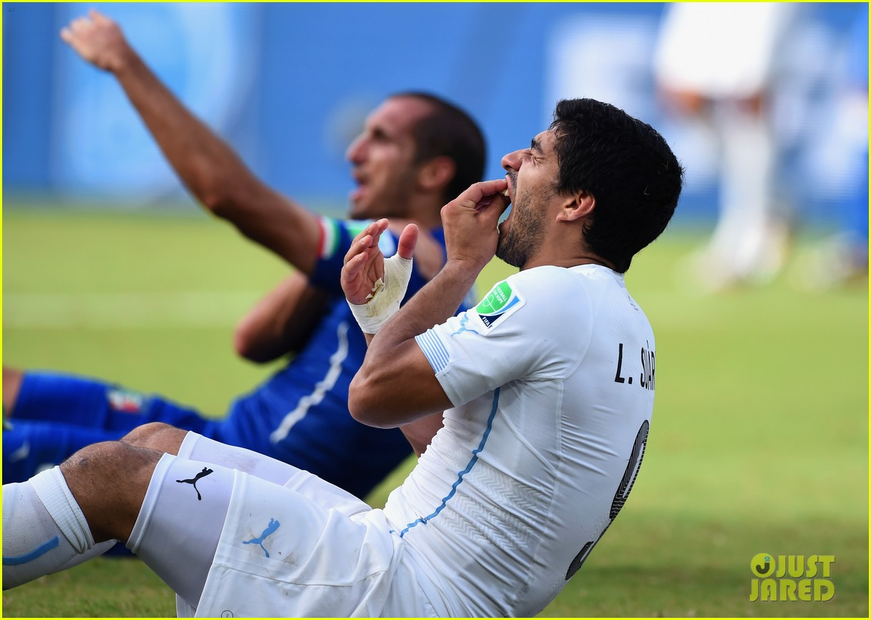 luis suarez banned from world cup for biting opponent 083143923