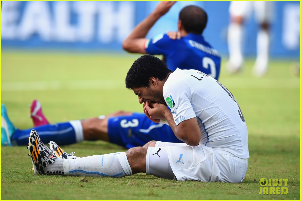 luis suarez banned from world cup for biting opponent 093143924