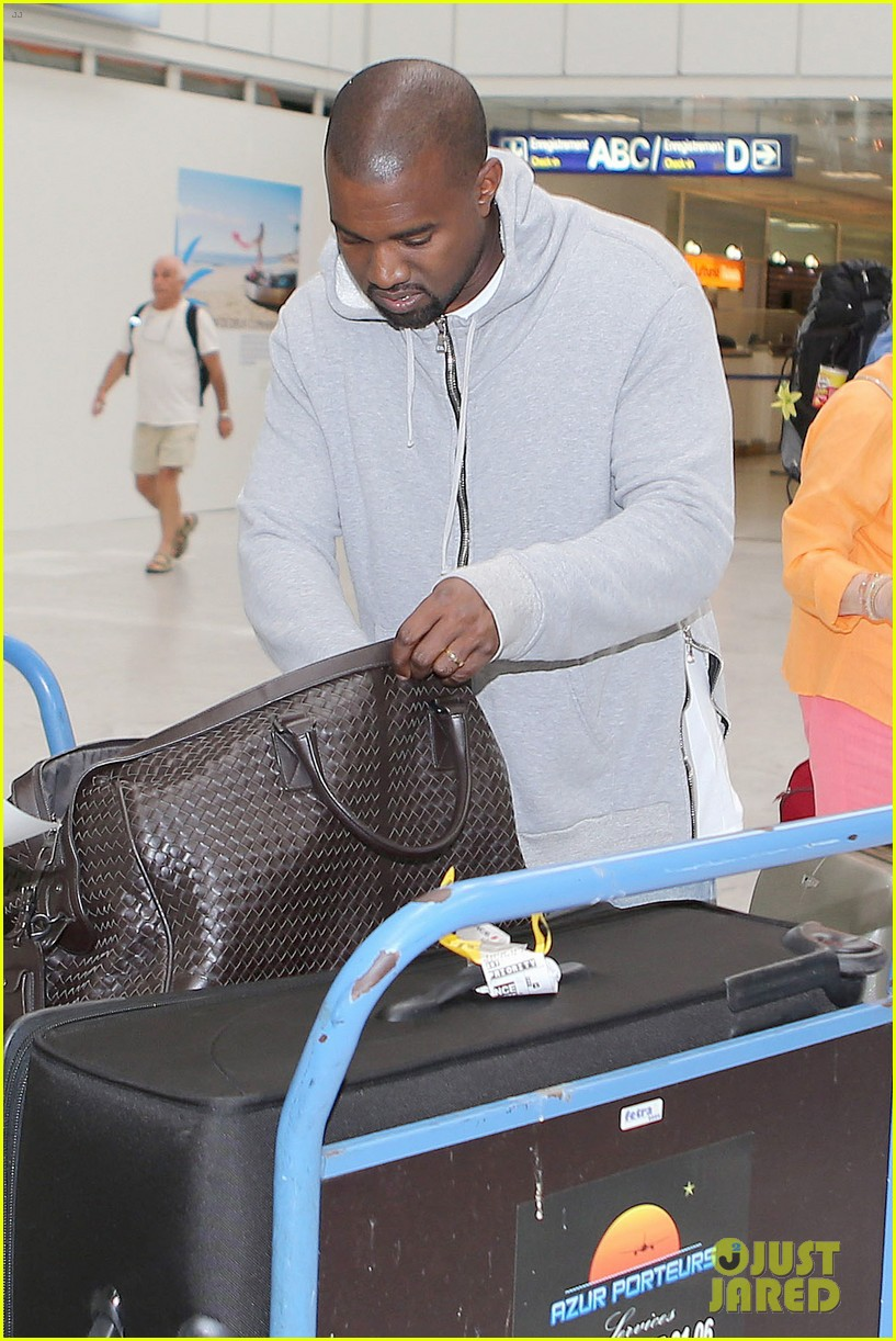 kim kardashian lands in nice while kanye west flies out 21