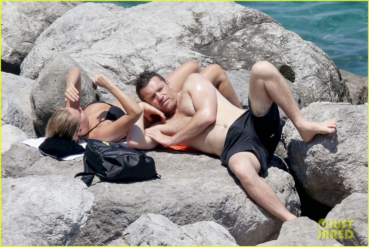 sam worthington lara bingle get handsy pack on the pda on beach 14