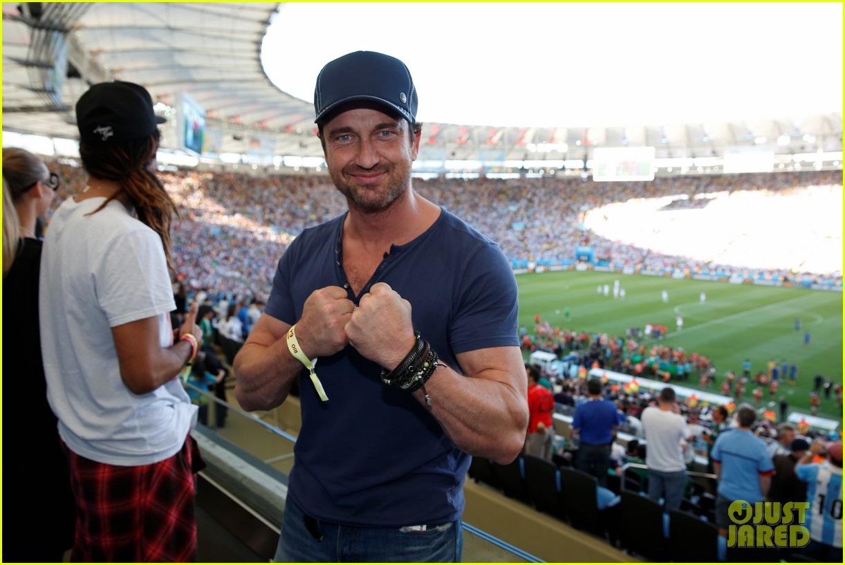 gerard butler packs on pda with mystery gal world cup 073156011