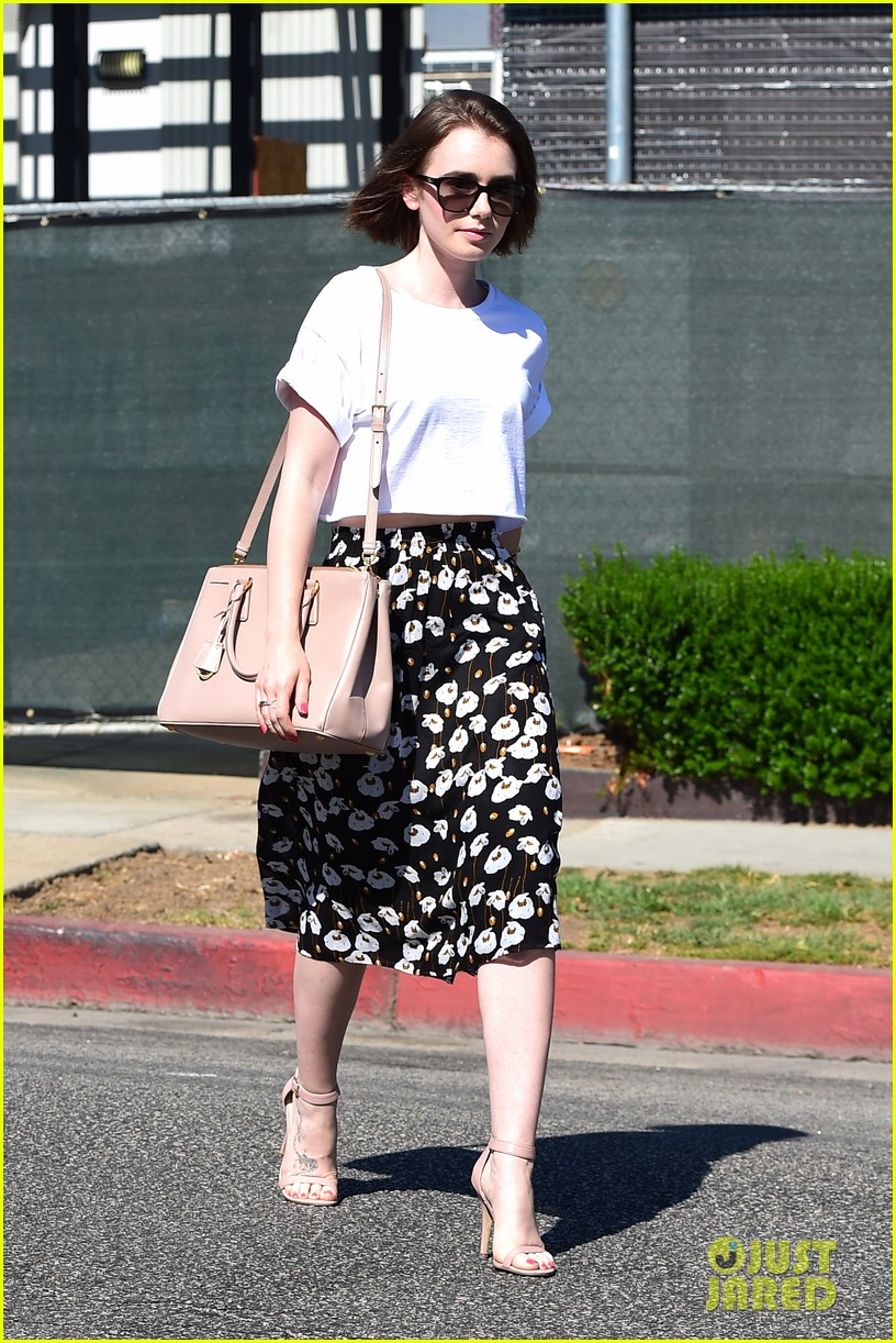 lily collins salon stop before holiday 163149250