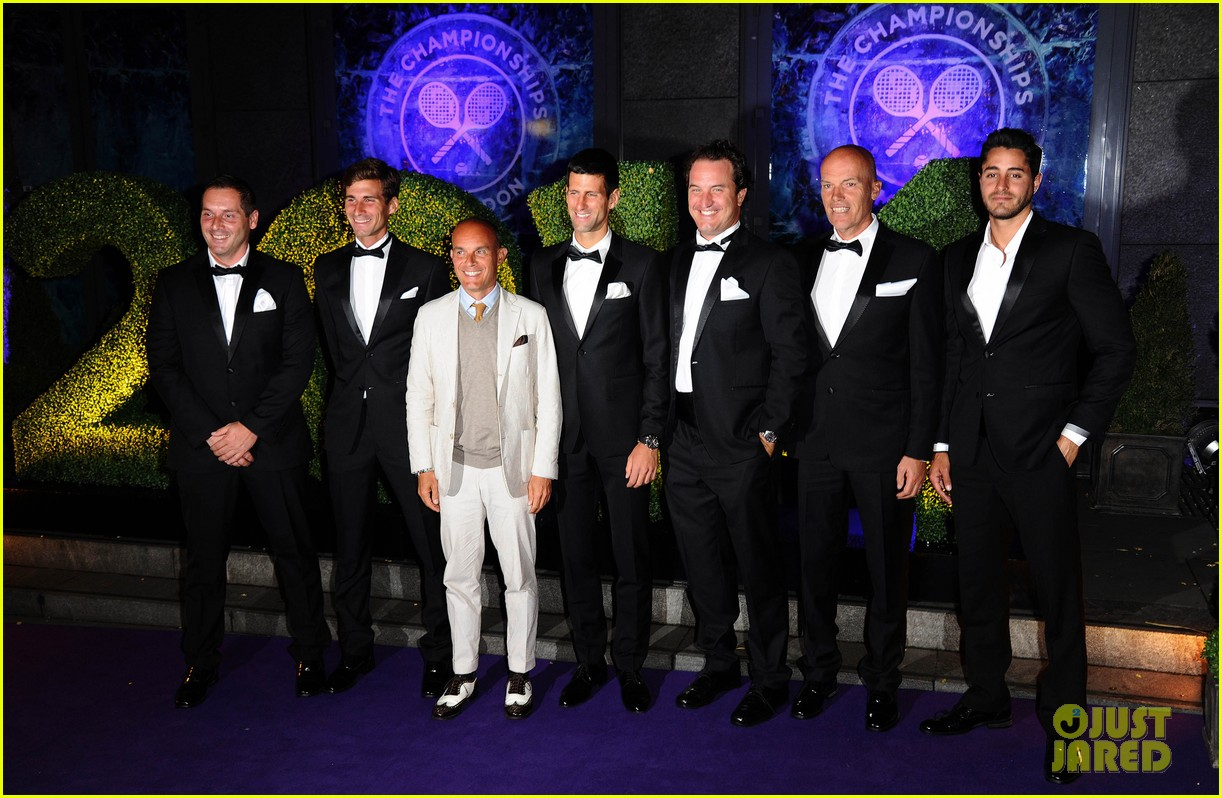 novak djokovic celebrates win at wimbledon championships winners ball 2014 053150863