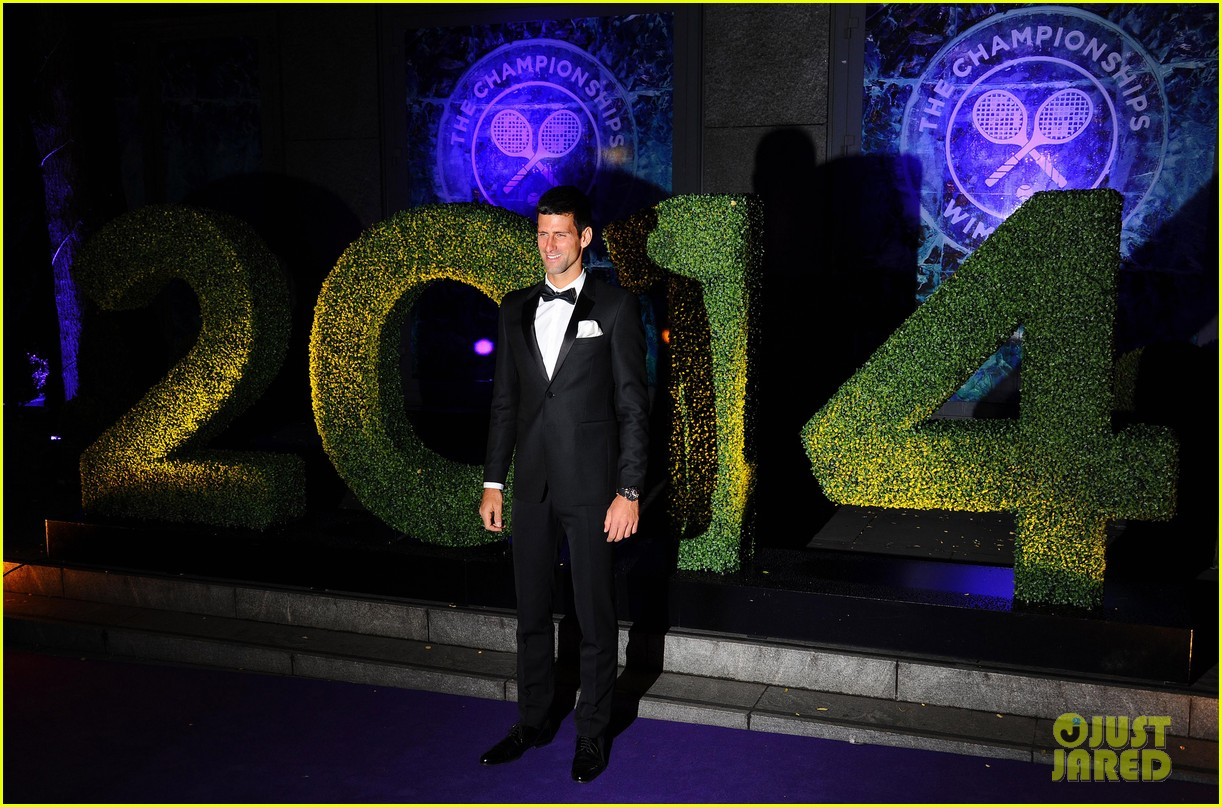 novak djokovic celebrates win at wimbledon championships winners ball 2014 093150867