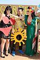 dita von teese flashes red bra in green dress 06