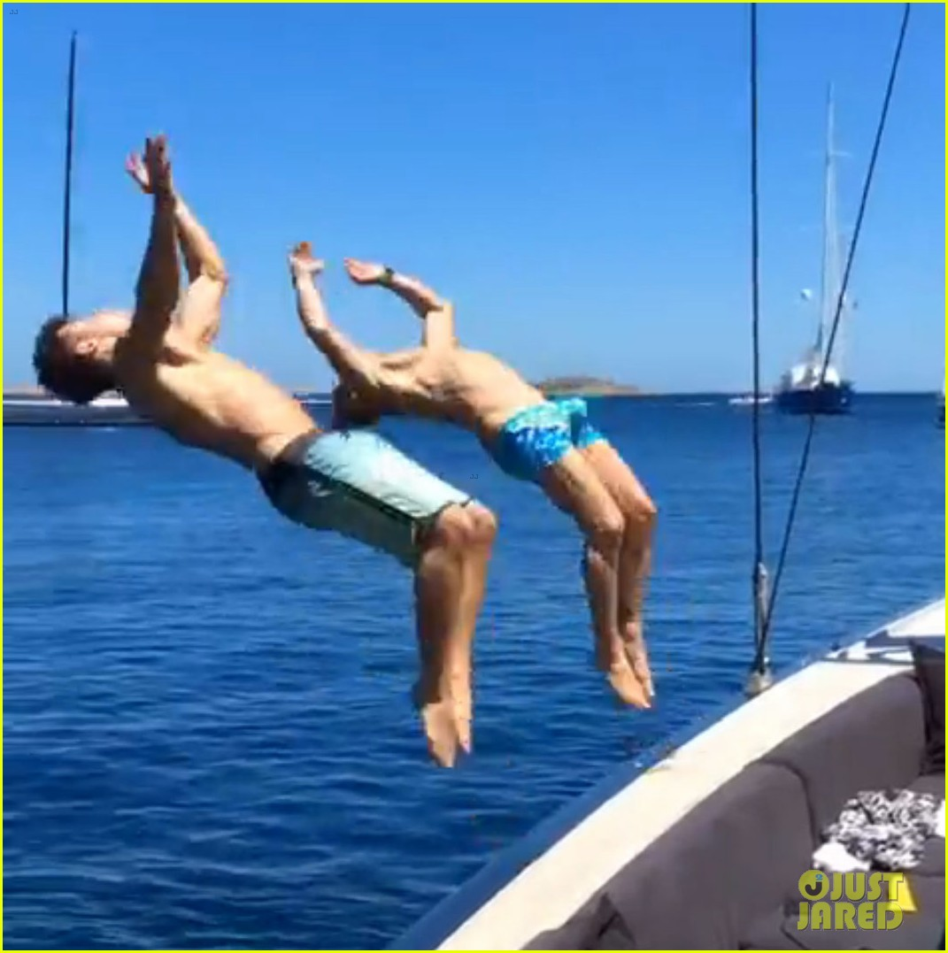 zac efron goes shirtless backflip off a boat 033149892
