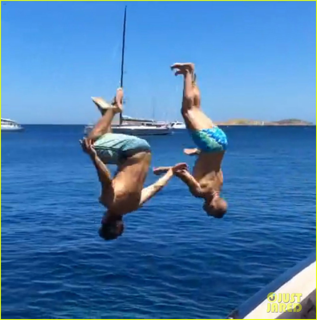 zac efron goes shirtless backflip off a boat 043149893