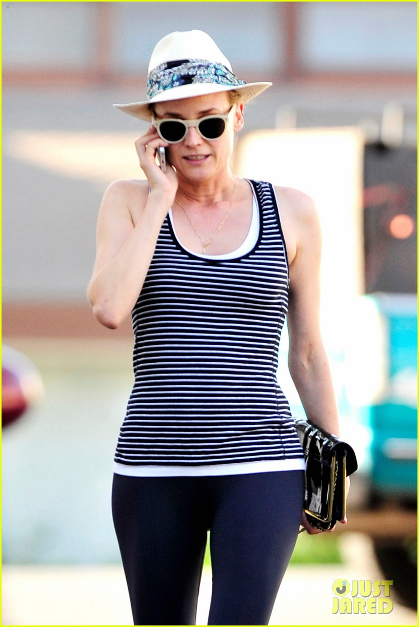 diane kruger keeps the suns rays out of her face with a cute hat 03
