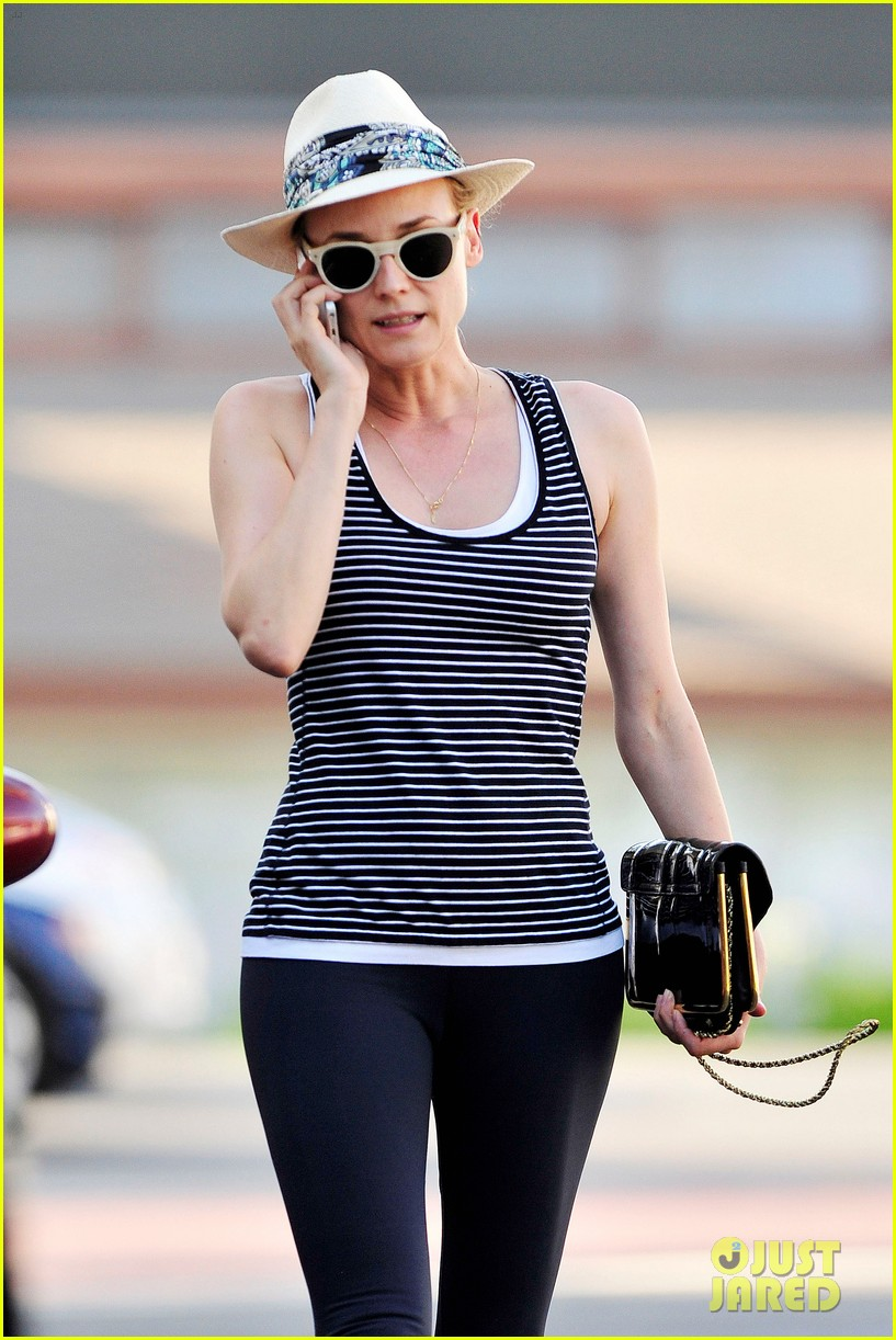 diane kruger keeps the suns rays out of her face with a cute hat 053147622
