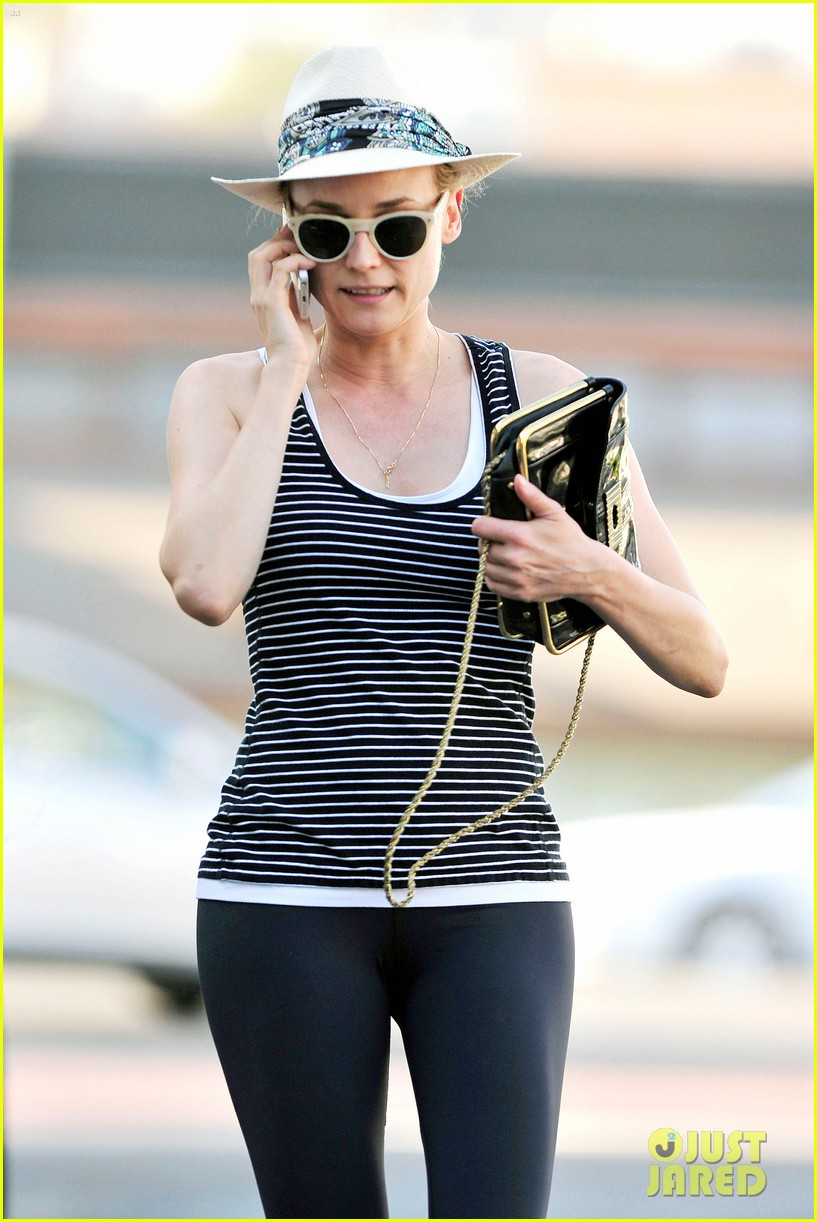 diane kruger keeps the suns rays out of her face with a cute hat 07