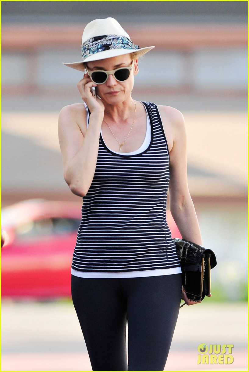 diane kruger keeps the suns rays out of her face with a cute hat 153147632