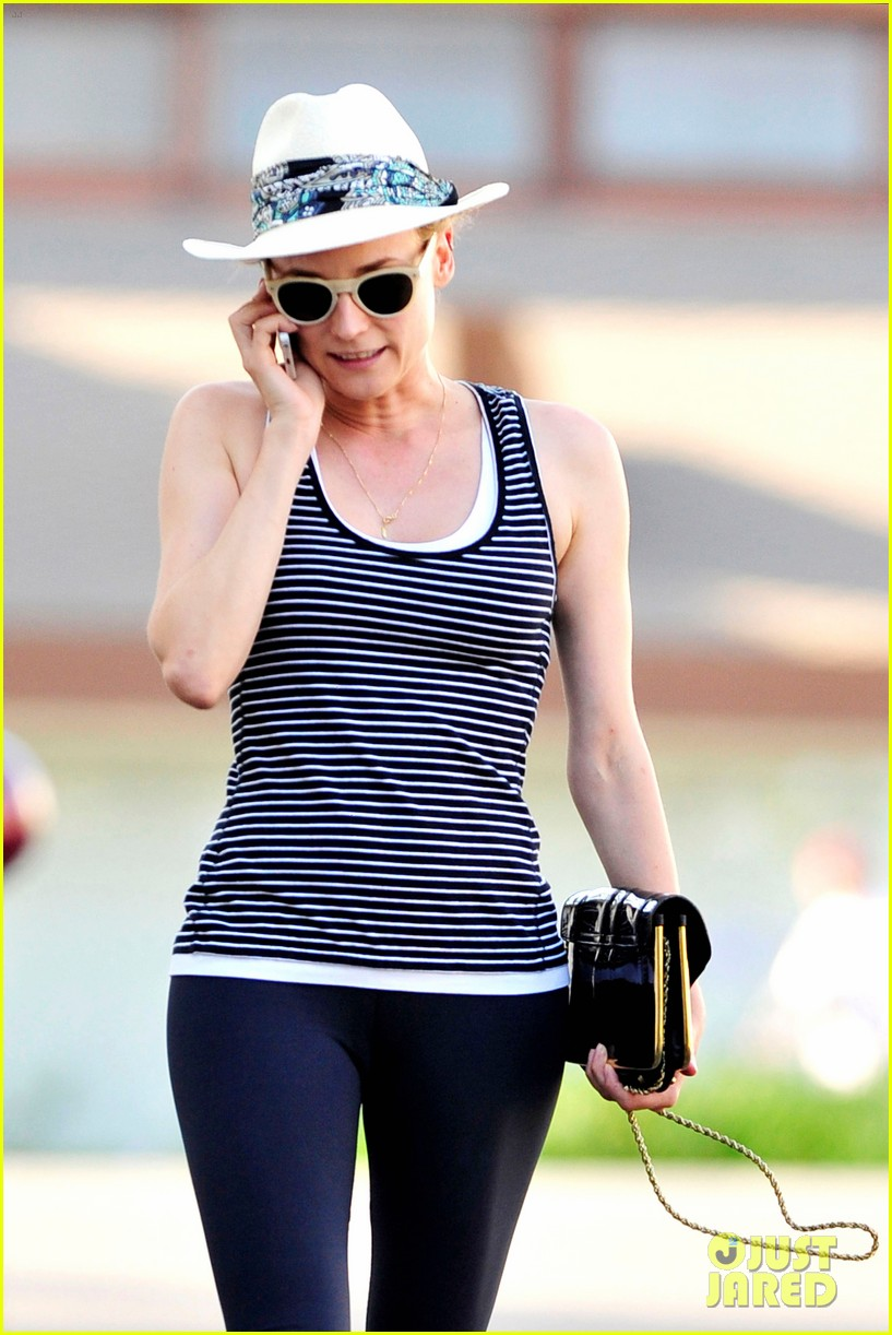 diane kruger keeps the suns rays out of her face with a cute hat 16