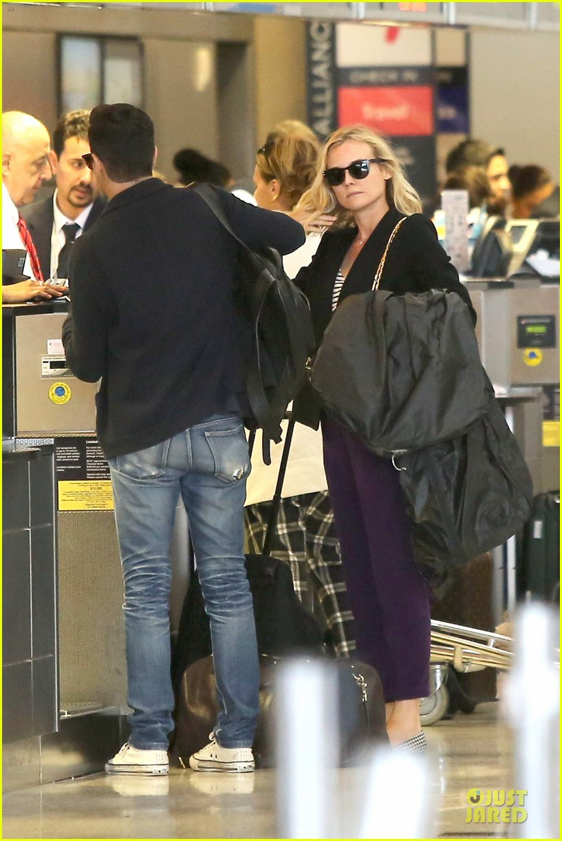 diane kruger wears purple pants at lax airport 013148004