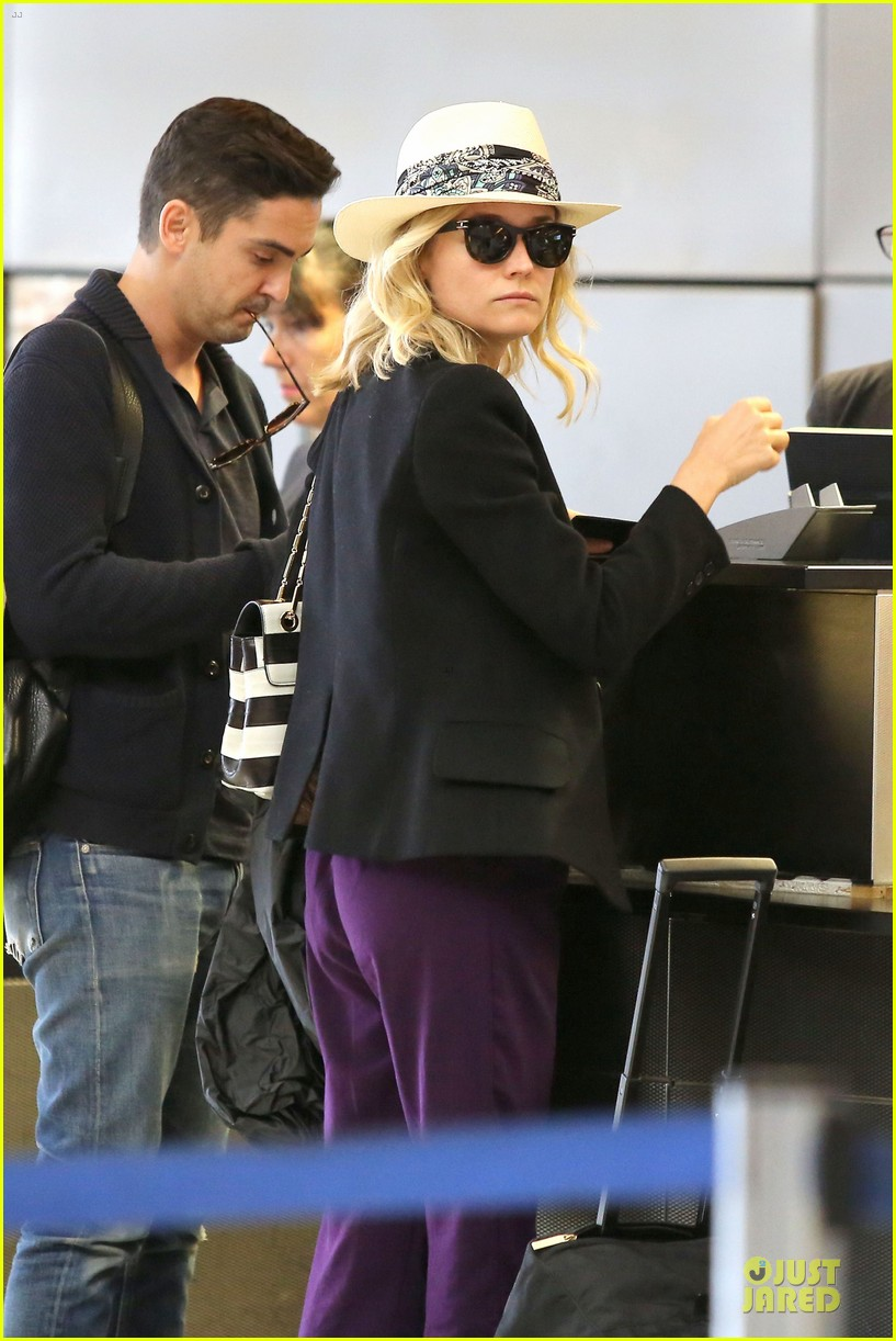 diane kruger wears purple pants at lax airport 023148005