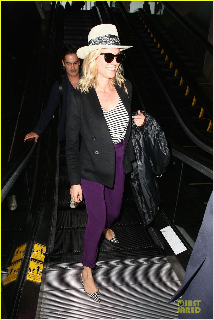 diane kruger wears purple pants at lax airport 053148008