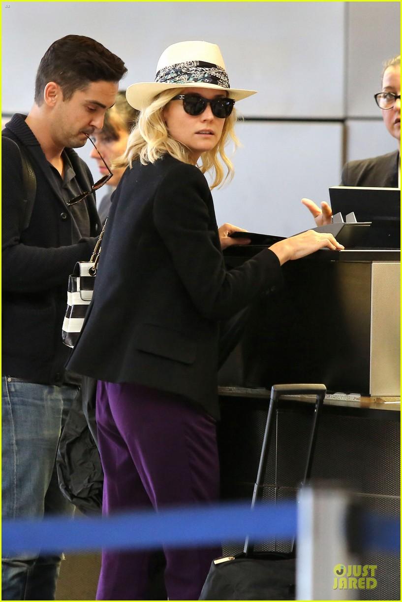 diane kruger wears purple pants at lax airport 063148009