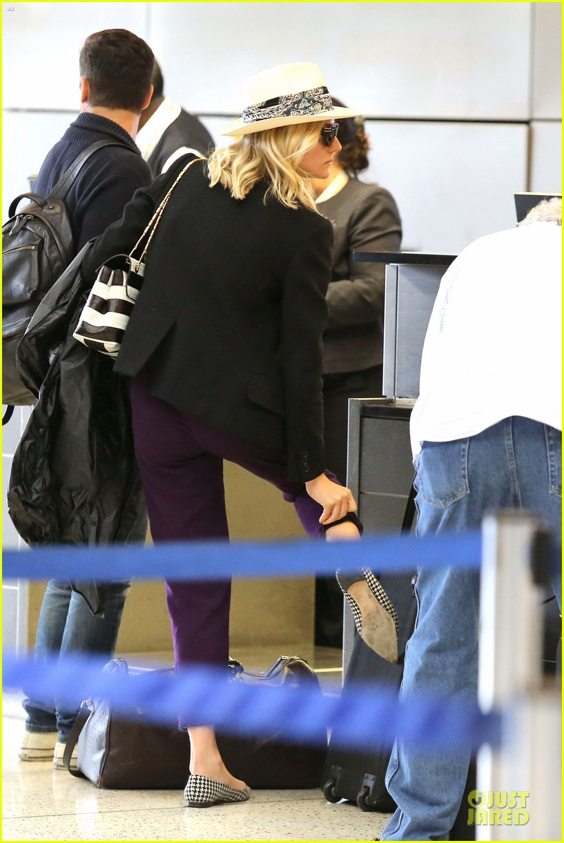 diane kruger wears purple pants at lax airport 07