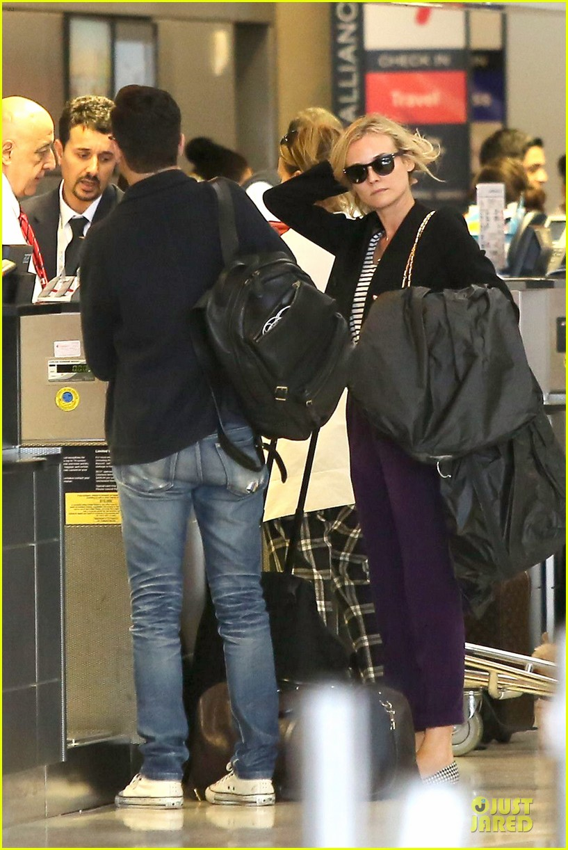 diane kruger wears purple pants at lax airport 08