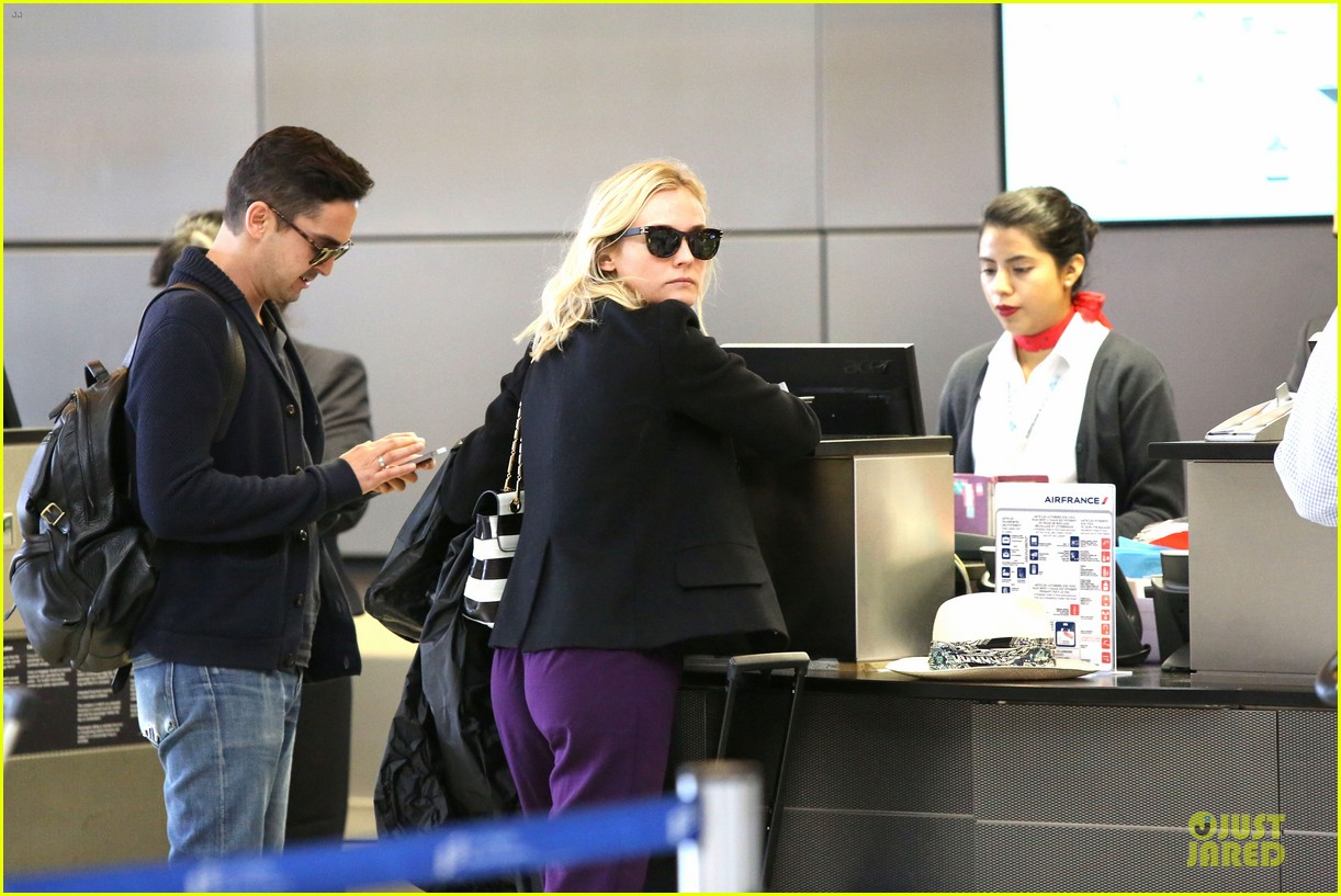 diane kruger wears purple pants at lax airport 093148012