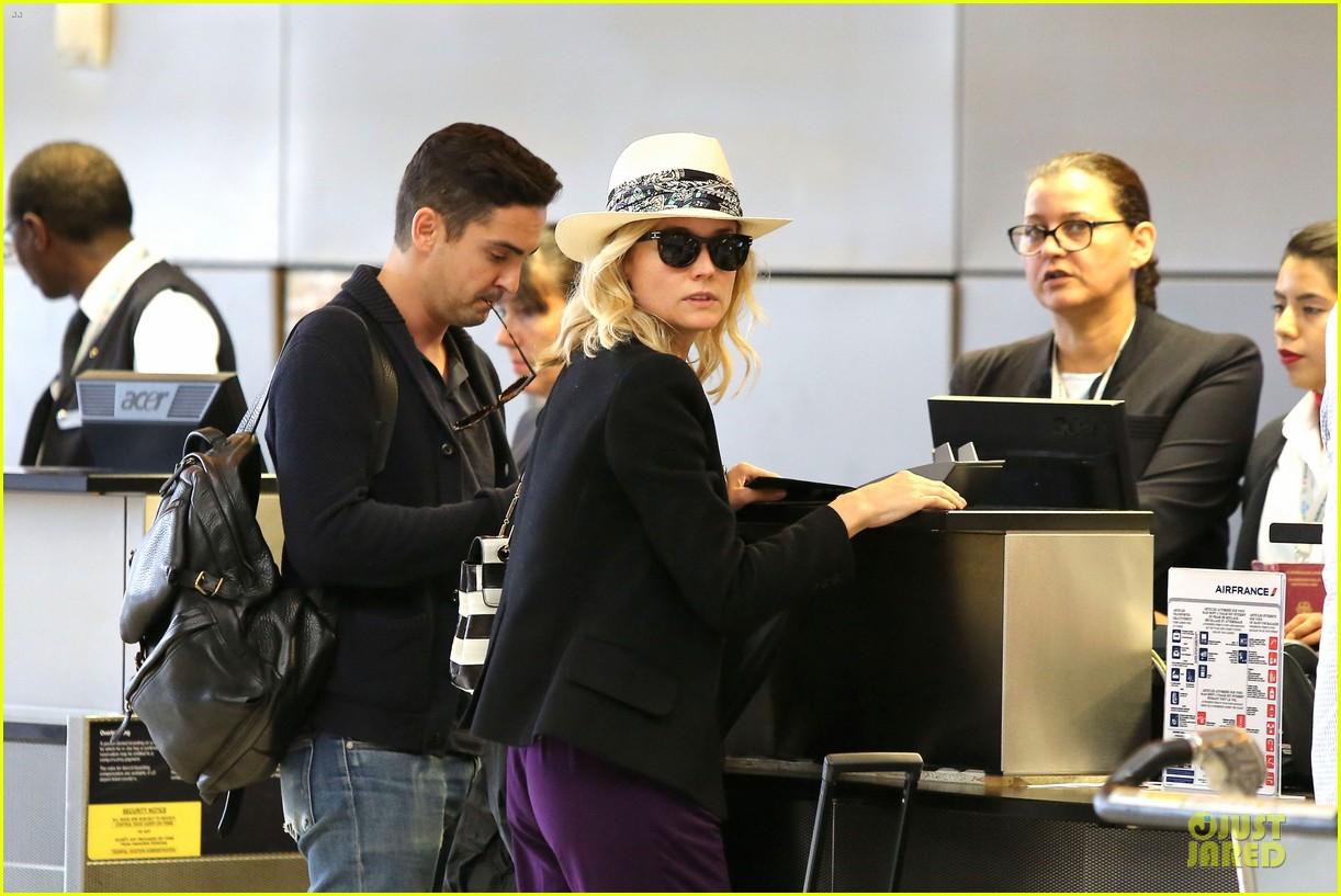diane kruger wears purple pants at lax airport 103148013