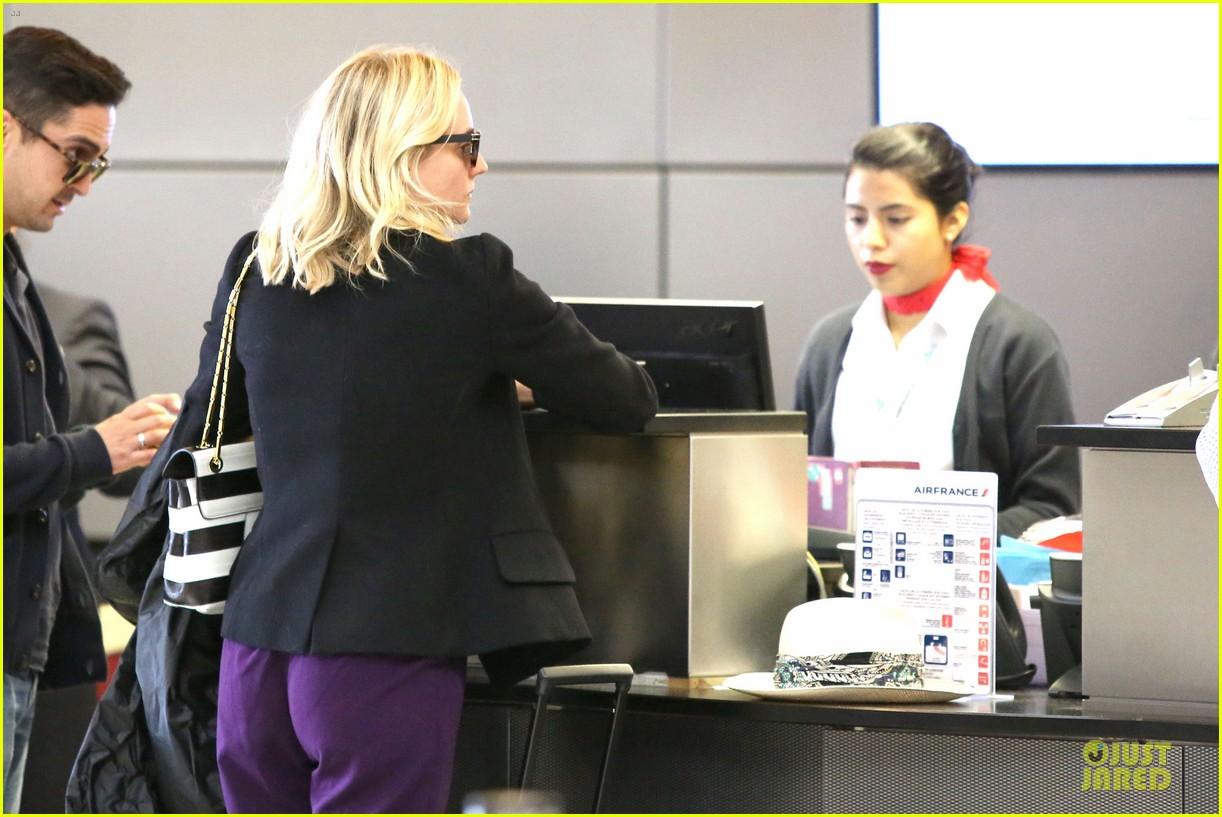 diane kruger wears purple pants at lax airport 113148014