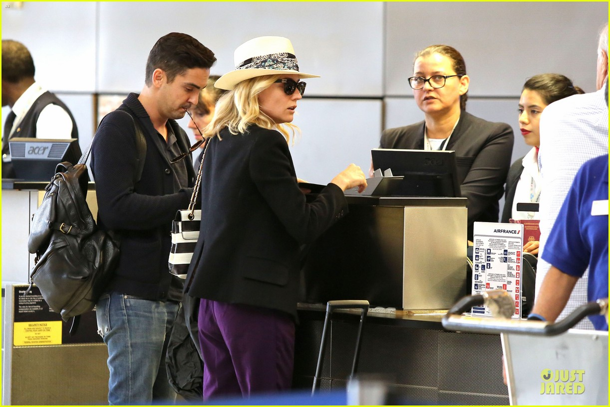 diane kruger wears purple pants at lax airport 12