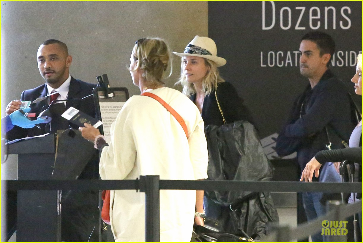diane kruger wears purple pants at lax airport 143148017