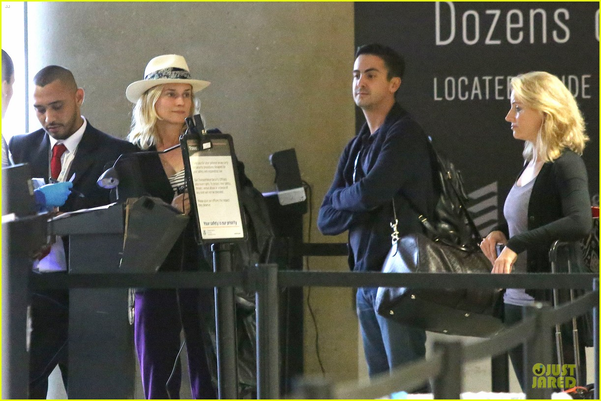 diane kruger wears purple pants at lax airport 153148018