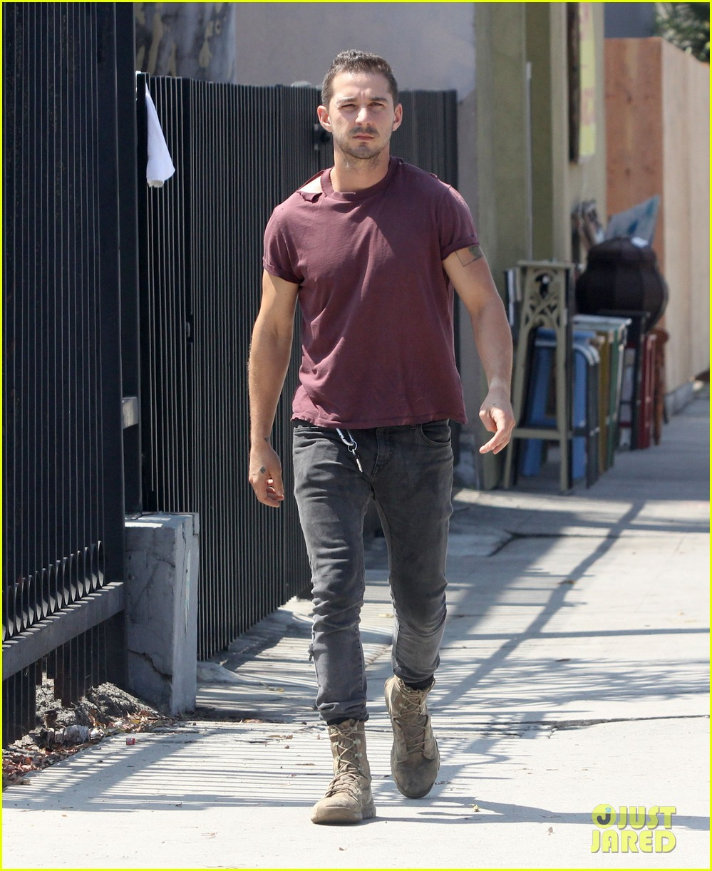 shia labeouf lifts his shirt bares torso 013153168