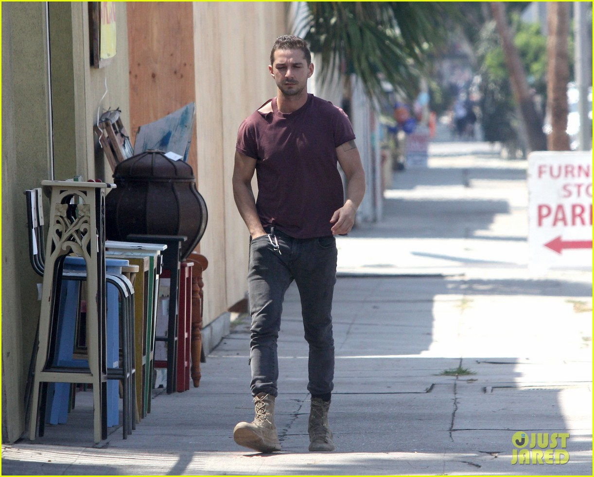 shia labeouf lifts his shirt bares torso 063153173