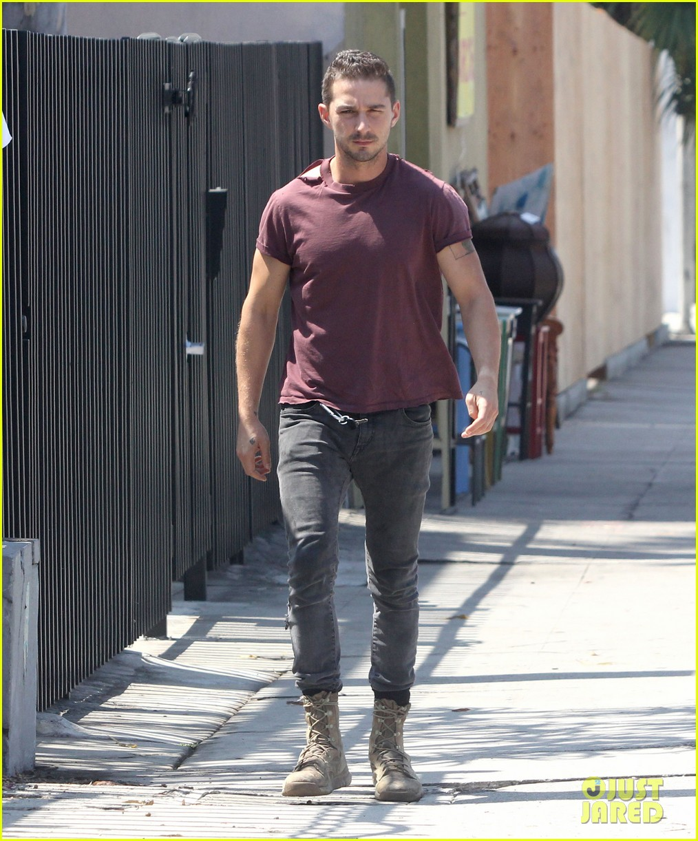 shia labeouf lifts his shirt bares torso 083153175