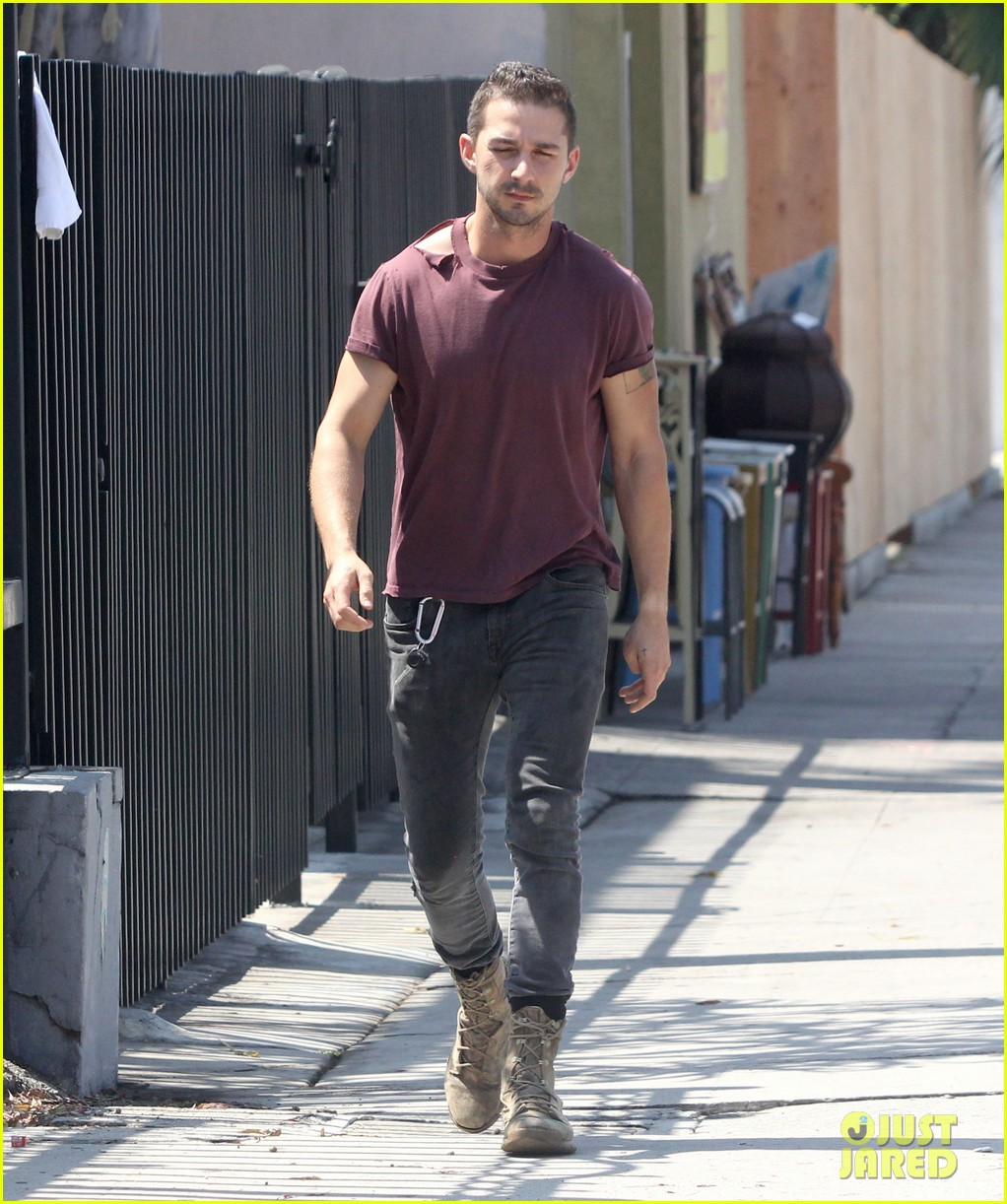 shia labeouf lifts his shirt bares torso 09