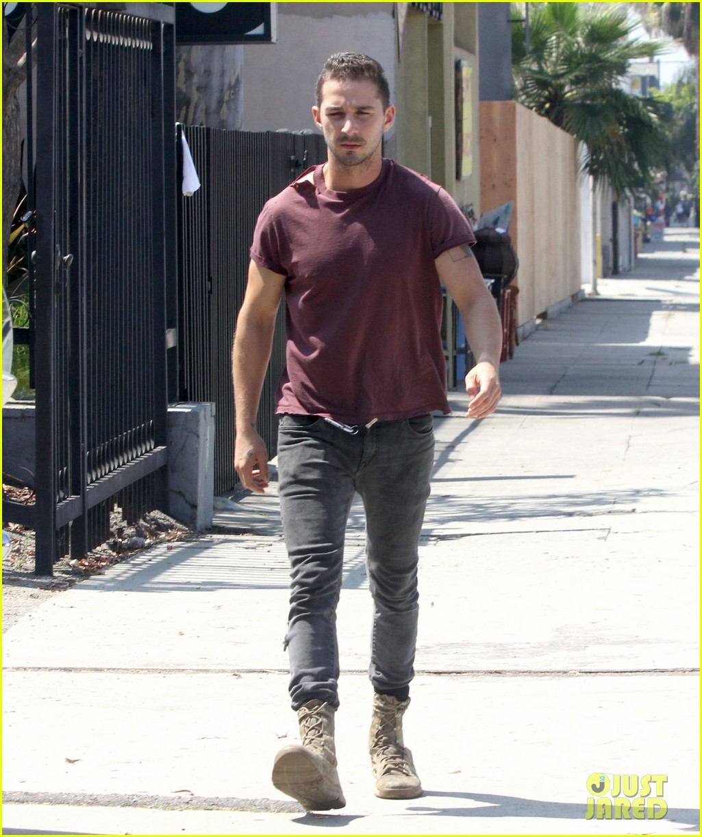 shia labeouf lifts his shirt bares torso 103153177