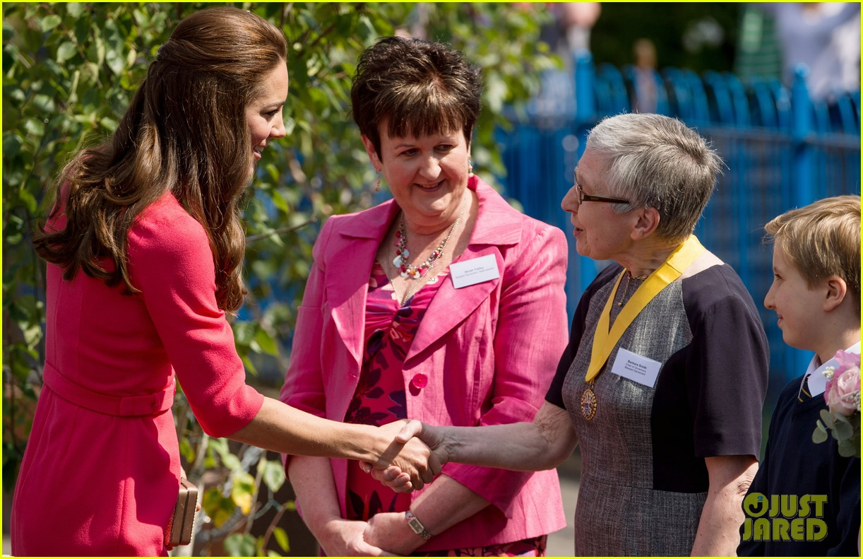 kate middleton is bright in pink for blessed sacrament school visit 11