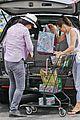 milla jovovich grocery trip friend 09