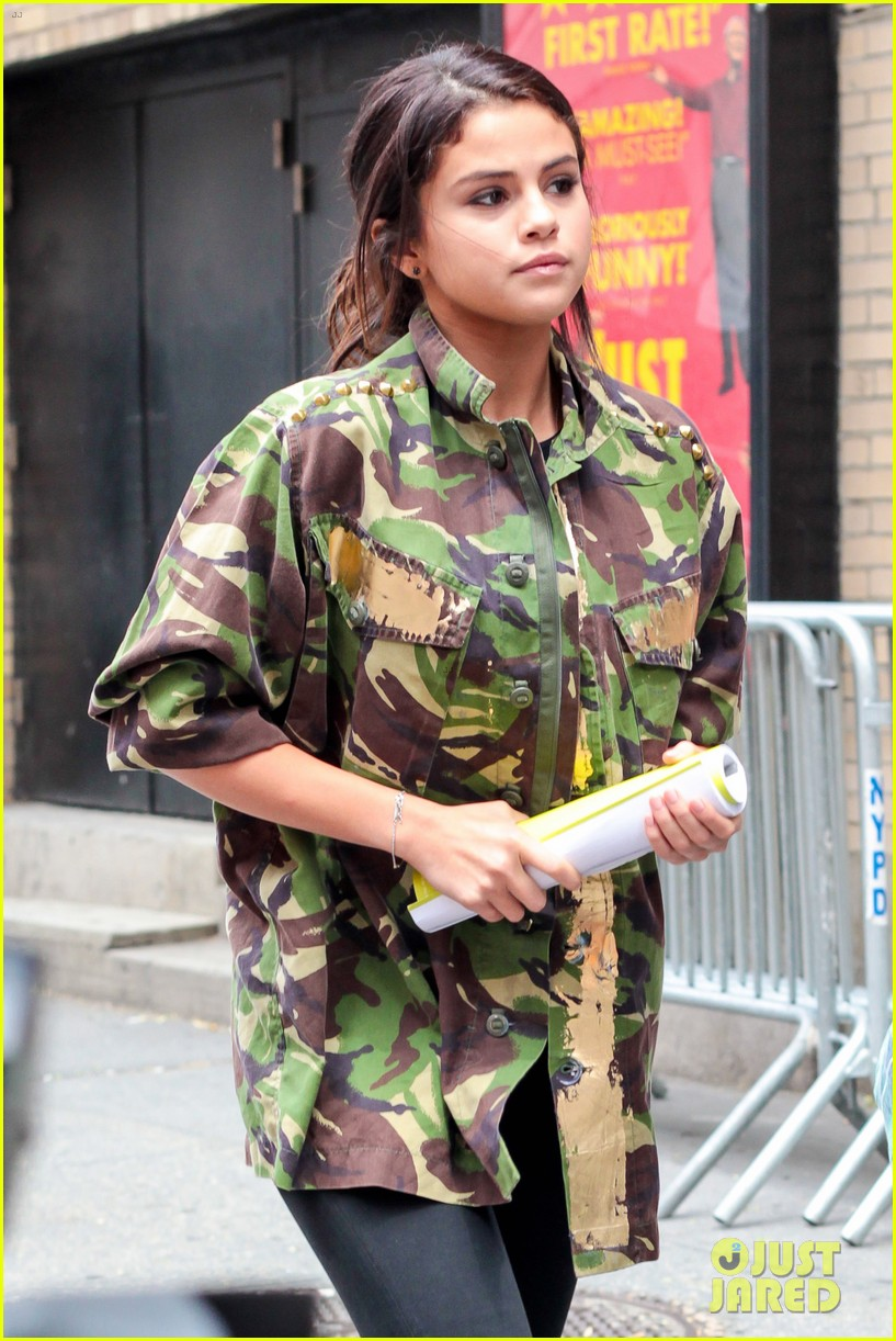 selena gomez covers up camo jacket 013153050