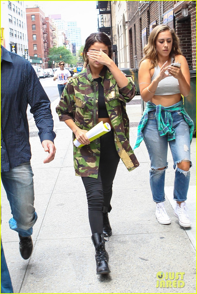 selena gomez covers up camo jacket 05