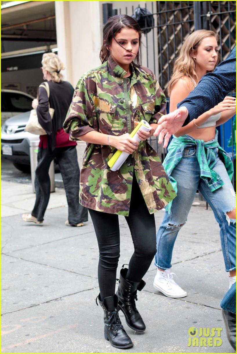 selena gomez covers up camo jacket 073153056