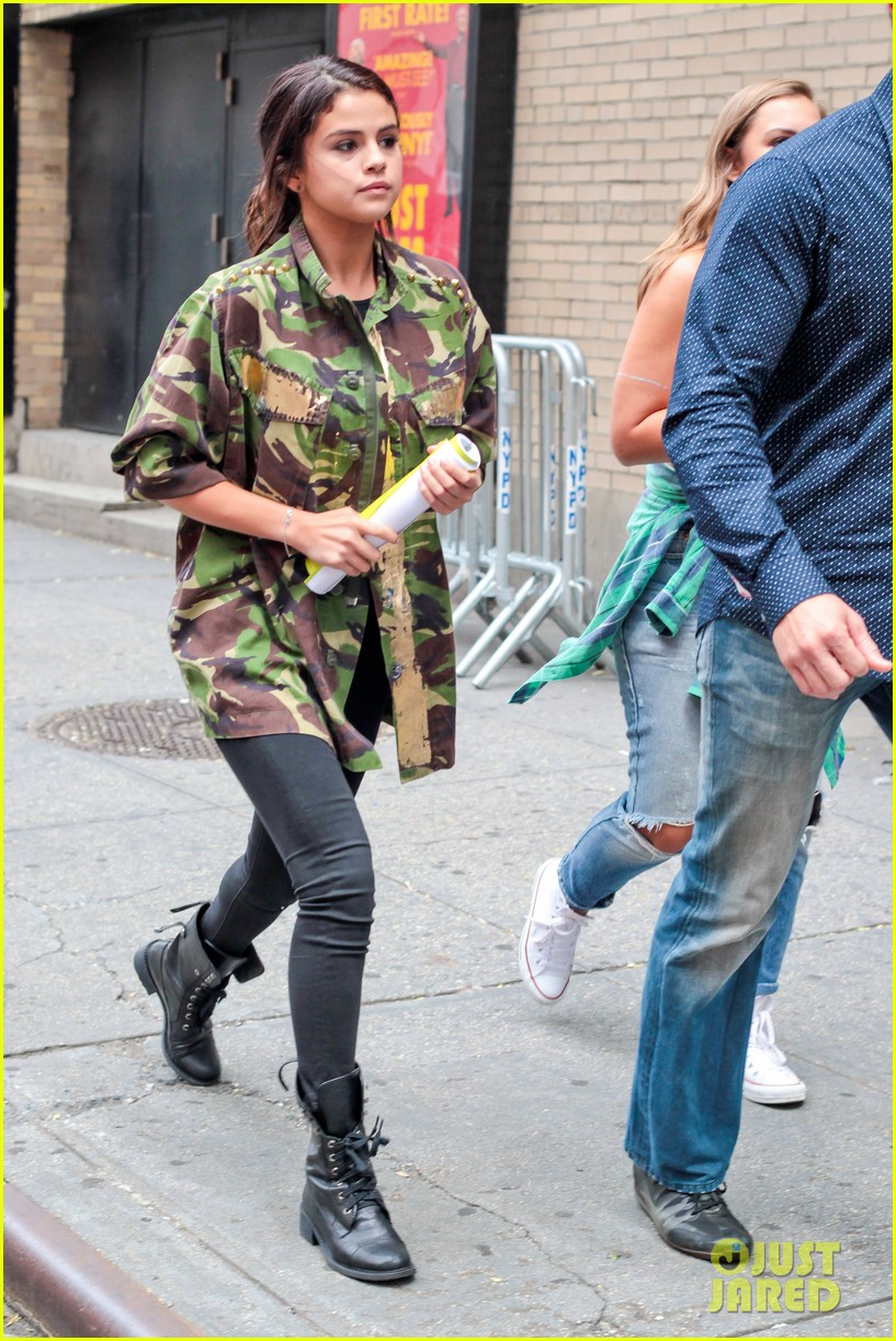 selena gomez covers up camo jacket 083153057