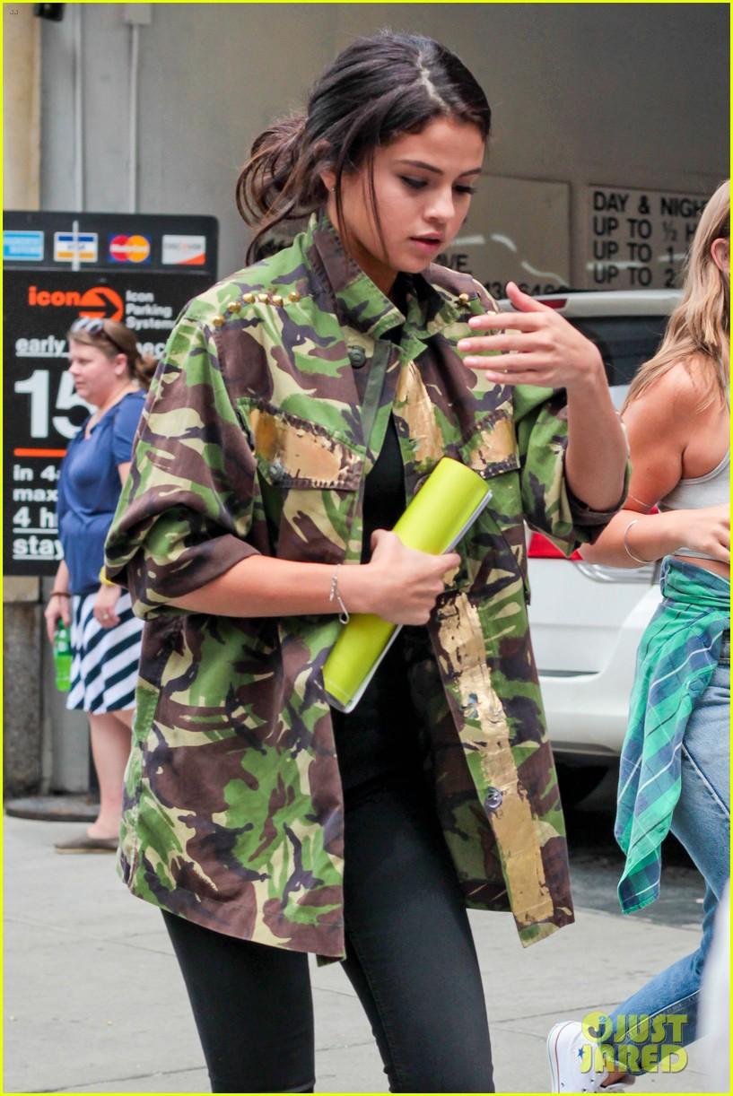 selena gomez covers up camo jacket 103153059