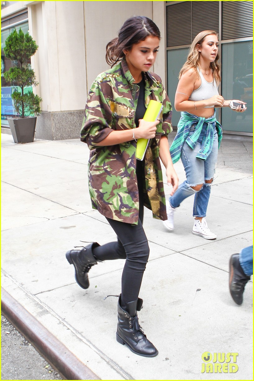 selena gomez covers up camo jacket 12