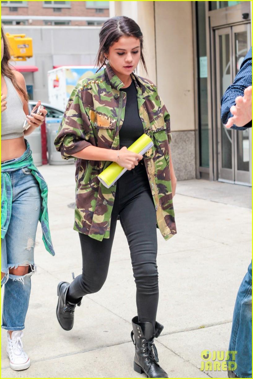 selena gomez covers up camo jacket 133153062